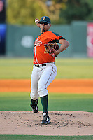 Pitcher Enderson Franco (28) of the Greensboro Grasshoppers delivers a pitch in a game against the Greenville Drive on Thursday, August 27, 2015, at Fluor Field at the West End in Greenville, South Carolina. Greenville won, 10-2.  (Tom Priddy/Four Seam Images)