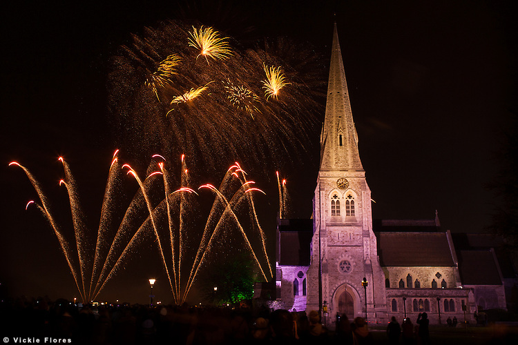 Fireworks explode behind All Saints church in Blackheath on 3 November 2012