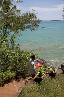 A waiter carries refreshments down steps leading to one of the many private areas on Taprobane Island