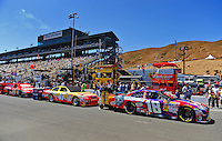 Jun. 21, 2009; Sonoma, CA, USA; The cars of NASCAR Sprint Cup Series drivers Kyle Busch (18), Marcos Ambrose (47) and Tony Stewart (14) sit on pit road prior to the SaveMart 350 at Infineon Raceway. Mandatory Credit: Mark J. Rebilas-