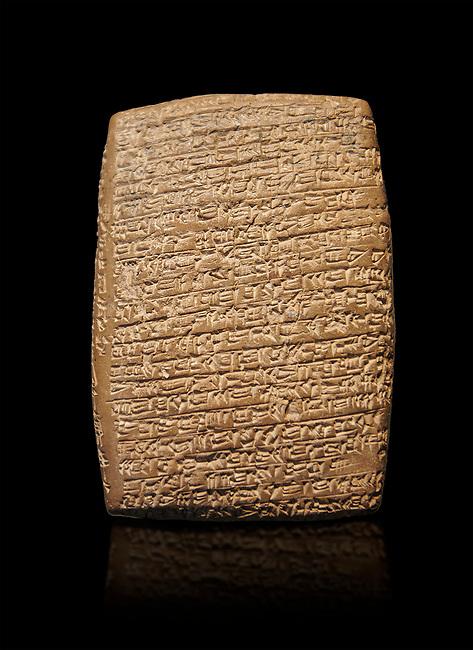 Hittite cuneiform tablet. Adana Archaeology Museum, Turkey. Against a black background