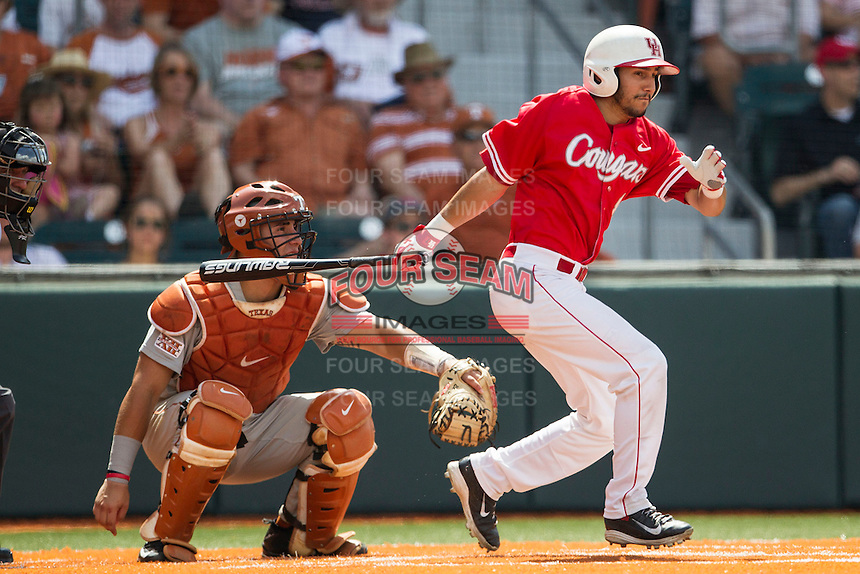Houston Cougars designated hitter Justin Montemayor (20) follows through on his swing during the NCAA baseball game against the Texas Longhorns on June 6, 2014 at UFCU Disch–Falk Field in Austin, Texas. The Longhorns defeated the Cougars 4-2 in Game 1 of the NCAA Super Regional. (Andrew Woolley/Four Seam Images)