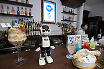 """A communication robot called """"Robi"""" stands at a bar counter during a press preview for """"Robi cafe"""" where visitors can interact with the robots while enjoying meals and drinks in Tokyo, Thursday, January 15, 2015. The robot can be built by assembling parts sent along with a weekly magazine by Deagostini. The cafe will open from January 16 until February 8. (Photo by Yuriko Nakao/AFLO)"""