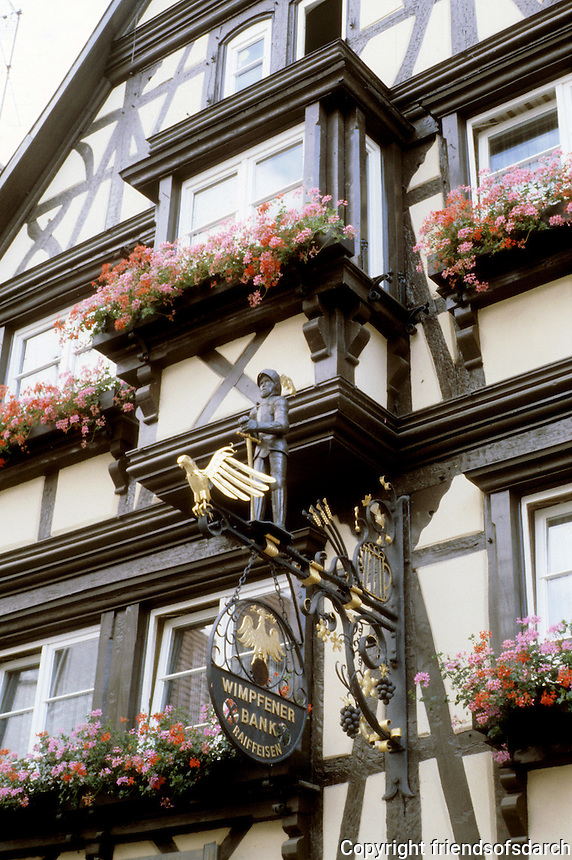 Bad Wimpfen: Fackwerk Facade. Beautiful hanging signage, flower boxes.