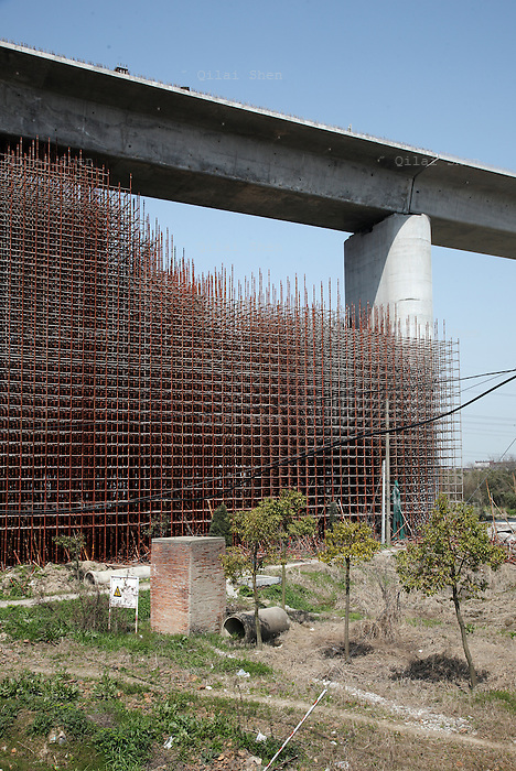 Scaffolding built of steel pipes stand in support of an elevated base for the planned Shanghai-Hangzhou high-speed rail near Shanghai, China on 17 March 2010.  In just a few years, China has built the world's longest high-speed rail network, named China Rail High-speed (CRH), and continues to expand despite accusations of technology pilfering and safety concerns. On July 23rd, 2011, two high-speed trains in eastern China collided due to supposed malfunctioning in the signaling system, killing 40 and injuring hundreds, meanwhile a slew of corruption scandals at China's rail ministry has surfaced recently. The Railways Ministry's debts have ballooned in recent years. At the end of the first quarter its obligations totaled 1.98 trillion yuan ($307 billion), about 5% of China's gross domestic product.