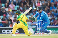 Usman Khawaja (Australia) sweep seems to ricochet of MS Dhoni (India) and runs are prevented during India vs Australia, ICC World Cup Cricket at The Oval on 9th June 2019