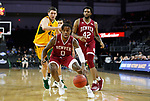 SIOUX FALLS, SD - MARCH 7: Ade Murkey #0 of the Denver Pioneers drives to the basket past Tyler Witz #44 of the North Dakota State Bison at the 2020 Summit League Basketball Championship in Sioux Falls, SD. (Photo by Richard Carlson/Inertia)