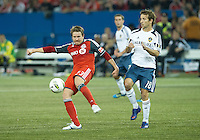 07 March 2012:LA Galaxy forward Mike Magee #18 and Toronto FC midfielder Terry Dunfield #23 in action during a CONCACAF Champions League game between the LA Galaxy and Toronto FC at the Rogers Centre in Toronto..The game ended in a 2-2 draw.