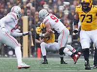 Ohio State Buckeyes defensive lineman Joey Bosa (97) sacks Minnesota Golden Gophers quarterback Mitch Leidner (7) in the first quarter of the college football game between the Ohio State Buckeyes and the Minnesota Golden Gophers at TCF Bank Stadium in Minneapolis, Saturday morning, November 15, 2014. As of half time the Ohio State Buckeyes led the Minnesota Golden Gophers 17 - 14. (The Columbus Dispatch / Eamon Queeney)