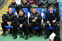 (L-R) Alan Curtis, assistant coach, Bjorn Hamberg, assistant coach, Billy Reid, assistant manager and Graham Potter Manager of Swansea City during the Sky Bet Championship match between Blackburn Rovers and Swansea City at Ewood Park in Blackburn, England, UK. Sunday 5th May 2019