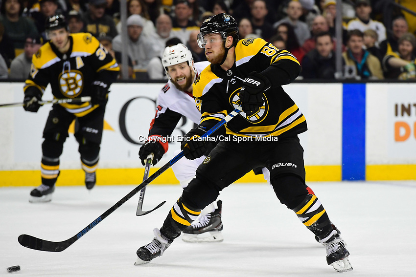 April 7, 2018: Boston Bruins right wing David Pastrnak (88) shoots the puck during the NHL game between the Ottawa Senators  and the Boston Bruins held at TD Garden, in Boston, Mass. Boston defeats Ottawa 5-2 Eric Canha/CSM