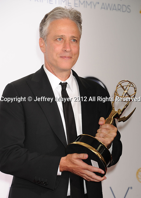 LOS ANGELES, CA - SEPTEMBER 23: Jon Stewart poses in the press room at the 64th Primetime Emmy Awards held at Nokia Theatre L.A. Live on September 23, 2012 in Los Angeles, California.