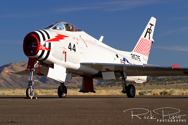 An FJ-4B Fury sits on the tarmac in the morning sun at Stead Field in Nevada. The FJ series of U.S. Navy aircraft were designed by North American Aviation in the 1940's at the same time as the Air Force F-86 Sabre. The FJ-4B is an attack version of the Fury and was the first jet designed to carry a nuclear weapon from the deck of an aircraft carrier <br />