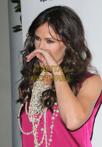 JENNIFER GARNER .at 6th Annual Pink Party held at Drai's at The W Hotel in Hollywood, California, USA, September 25th 2010..portrait headshot pink sleeveless pearls pearl beads necklace   hand wiping nose funny                                          .CAP/RKE/DVS.©DVS/RockinExposures/Capital Pictures.
