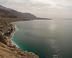 The Jordanian coast, Dead Sea.  The shore of the Dead Sea is white with salt crystals, and salt on the bottom makes the water appear green in the shallows.  © Rick Collier