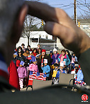 WATERBURY, CT. 07 December 2006--120706SV03--Children and staff sing songs while dressed in flag hats during a Pearl Harbor day ceremony at the Muriel Moore Child Development Center in Waterbury Thursday.  New Opportunities Inc. sponsored the event with veterans at the child center.<br /> Steven Valenti Republican-American