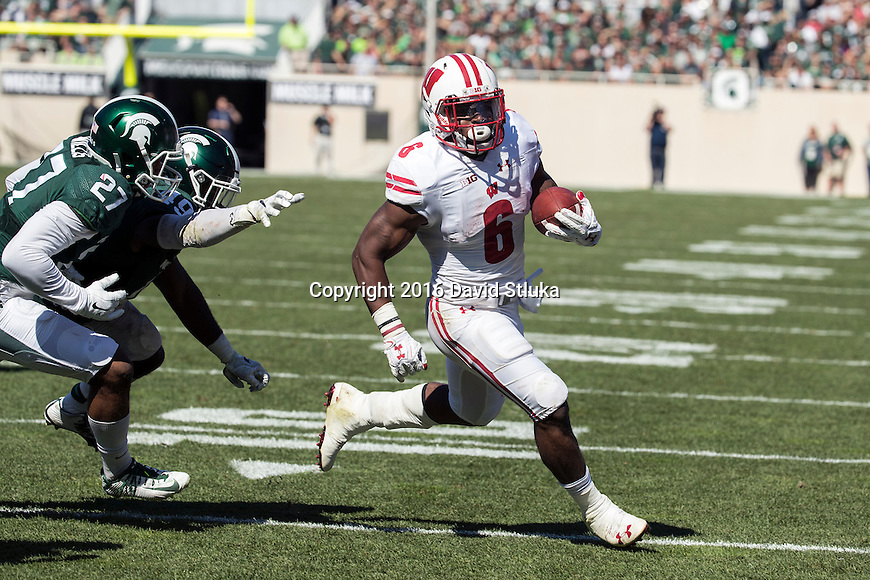 Wisconsin Badgers running back Corey Clement (6) scores a touchdown during an NCAA college football game against the Michigan State Spartans Saturday, September 24, 2016, in East Lansing, Michigan.  (Photo by David Stluka)