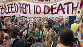 A group of demonstrators hold placards and a banner during the Climate Change demonstration, London, 21st September 2014. © Sue Cunningham