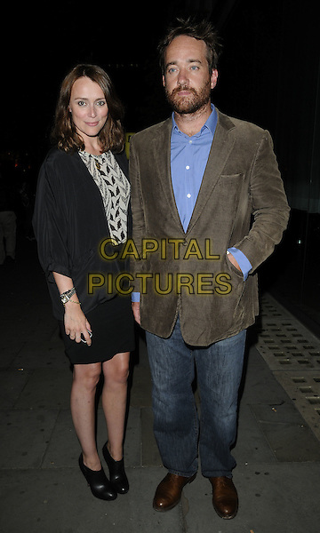 "KEELEY HAWES & MATTHEW MacFADYEN.The ""Ghost Stories"" VIP evening, Duke of York's Theatre, London, England..July 14th, 2010.full length black skirt jacket white gold brown pattern top ankle boots jacket beard facial hair jeans denim married husband wife cords corduroy .CAP/CAN.©Can Nguyen/Capital Pictures."