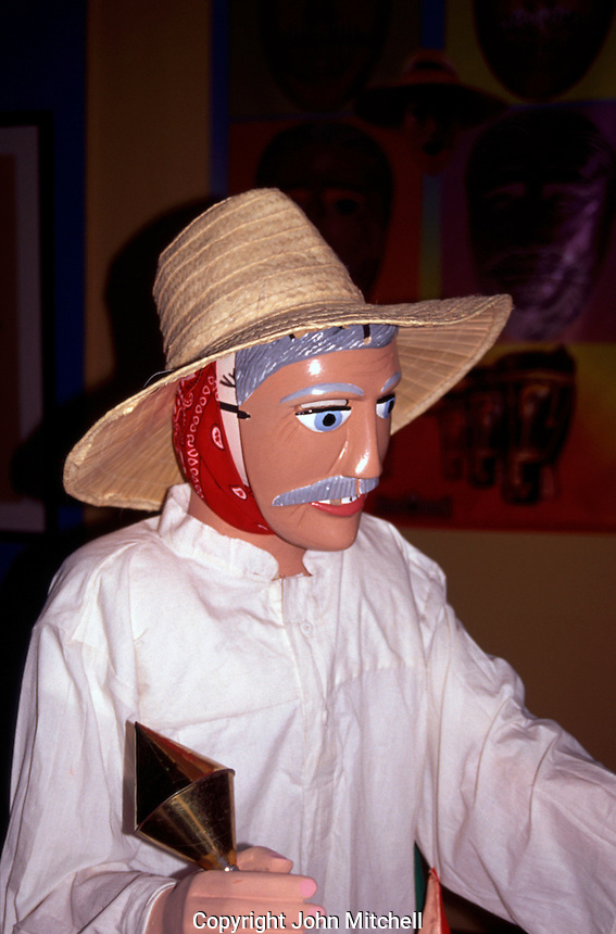 Figure wearing Spanish conquistador mask in the National Museum , Managua , Nicaragua . Mask used in the Gueguense or Macho Raton dance performed during the San Sebastian festival in the town of Diriamba .
