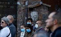 Faithful wearing masks to protect themselves from the Covid-19 arrive to attend the penitential procession on Ash Wednesday, led from the Pope to open Lent in Rome, February 26, 2020. Faithful wearing masks to protect themselves from the Covid-19 arrive to attend the penitential procession on Ash Wednesday, led from the Pope to open Lent in Rome, February 26, 2020.<br /> UPDATE IMAGES PRESS/Riccardo De Luca
