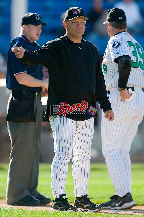 Winston-Salem pitching coach J.R. Perdew (31) signals to the bullpen for a relief pitcher versus Frederck at Ernie Shore Field in Winston-Salem, NC, Sunday, May 6, 2007