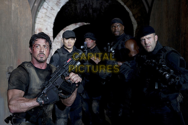 Sylvester Stallone, Jet Li, Randy Couture, Terry Crews, Jason Statham.in The Expendables (2010) .*Filmstill - Editorial Use Only*.CAP/NFS.Supplied by Capital Pictures.