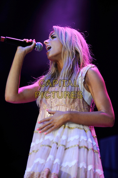 STACEY SOLOMON.Performs at the 1st Birthday Party of The Transformation Trust at the O2 Arena, London, England..July 13th, 2010.half length stage concert live gig performance music white pink sheer dress singing.CAP/IA.©Ian Allis/Capital Pictures.