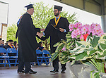 David Tingle of Sparks accepts his Associate of Science diploma during the 2015 Western Nevada College Commencement held at the Pony Express Pavilion in Carson City, Nev., on Monday, May 18, 2015.<br /> Photo by Tim Dunn