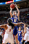 SIOUX FALLS, SD - MARCH 8:  Macy Miller #12 from South Dakota State University spots up for a jumper over Jasmine Trimbole #5 from the University of South Dakota in the 2016 Summit League Championship Game Tuesday afternoon in Sioux Falls. (Photo by Dave Eggen/Inertia)