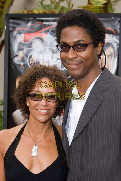 "STEPHANIE ALLAIN & GUEST.At the ""Hustle & Flow"" Los Angeles Film Premiere,.held at the Arclight Cinerama Dome, .Hollywood, California, USA, 20th July 2005..portrait headshot sunglasses.Ref: ADM.www.capitalpictures.com.sales@capitalpictures.com.©Zach Lipp/AdMedia/Capital Pictures."