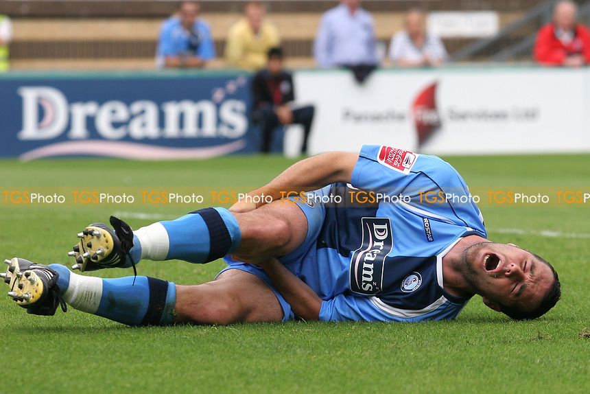 Scott McGleish of Wycombe Wanderers feels the pain after suffering an injury during Wycombe Wanderers vs Lincoln City, Coca Cola League Division Two Football at Adams Park on 23rd August 2008