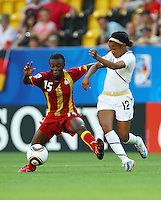 USA's Zakiya Bywaters (R) and Juliet Acheampong of Ghana during the FIFA U20 Women World Cup at the Rudolf Harbig Stadium in Dresden, Germany on July 14th, 2010.