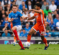 Portsmouth's Ben Thompson (left) battles with Shrewsbury Town's Josh Laurent (right) <br /> <br /> Photographer David Horton/CameraSport<br /> <br /> The EFL Sky Bet League One - Portsmouth v Shrewsbury Town - Saturday September 8th 2018 - Fratton Park - Portsmouth<br /> <br /> World Copyright &copy; 2018 CameraSport. All rights reserved. 43 Linden Ave. Countesthorpe. Leicester. England. LE8 5PG - Tel: +44 (0) 116 277 4147 - admin@camerasport.com - www.camerasport.com