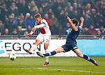Nederland, Amsterdam, 20 januari 2013.Eredivisie.Seizoen 2012-2013.Ajax-Feyenoord.Viktor Fischer (l.) van Ajax scoort de 2-0. Rechts Joris Mathijsen van Feyenoord.