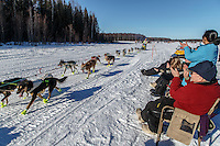 Spectators clap and cheer on Monica Zappa on Long Lake during the Restart of the 2016 Iditarod in Willow, Alaska.  March 06, 2016.