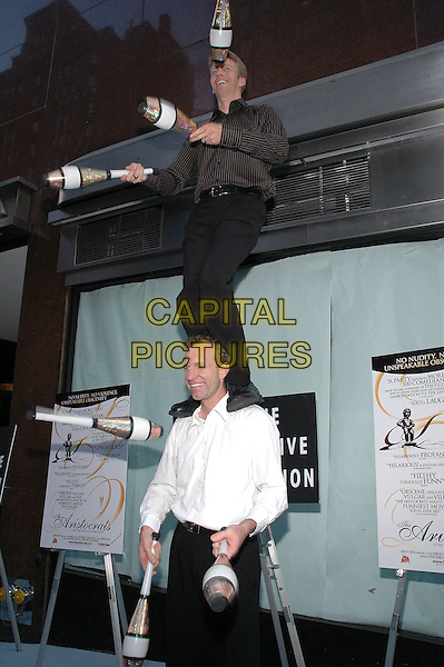 "26 July 2005 - New York, New York - John Wee and Owen Morse of ""The Passing Zone"" show off their skills as they arrive at the premiere of their new film, ""The Aristocrats"", at The Directors Guild Theater in Manhattan.  .Photo Credit: Patti Ouderkirk/AdMedia"