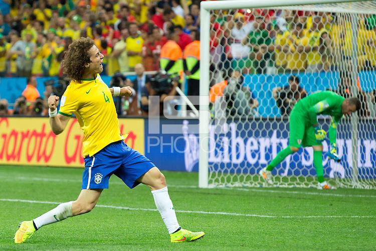 David Luiz of Brazil celebrates a goal scored by his team mate Oscar