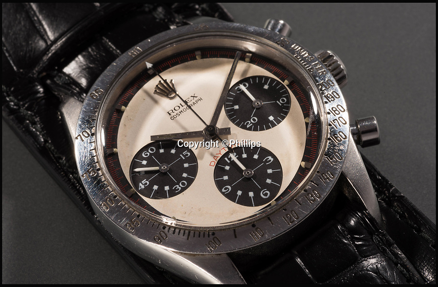 BNPS.co.uk (01202 558833)<br /> Pic: Phillips/BNPS<br /> <br /> A rare Rolex watch owned by the late movie star Paul Newman today sold for a world record £13.5m.<br /> <br /> The legendary actor received the Rolex Cosmograph Daytona as a present from his wife Joanne Woodward in 1968. <br /> <br /> She bought the timepiece from the prestigious Tiffany & Co store in New York and had it engraved with the message 'drive carefully' in light of her husband's fledgling motor racing career.<br /> <br /> Newman wore it daily for more than 15 years before passing it on to his daughter's then boyfriend, James Cox, while he stayed with the family one summer in the early 1980s<br /> <br /> It sold at Phillips Auctions of New York.