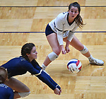 Althoff player Katie Wemhoener (left) digs for a Minooka serve as libero Claire Franke looks on. Althoff lost to Minooka in the championship game of the O'Fallon Class 4A volleyball sectional at O'Fallon HS in O'Fallon, IL on November 6, 2019.<br /> Tim Vizer/Special to STLhighschoolsports.com