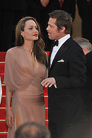 ANGELINA JOLIE &amp; BRAD PITT<br /> The &quot;Inglourious Basterds&quot; Premiere at the Grand Theatre Lumiere during the 62nd Annual Cannes Film Festival, Cannes, France.<br /> May 20th, 2009<br /> length half 3/4 dress sheer wrap beige pink cream black tuxedo couple goatee facial hair slit split thigh red lipstick hand profile<br /> CAP/PL<br /> &copy;Phil Loftus/Capital Pictures /MediaPunch ***NORTH AND SOUTH AMERICAS ONLY***
