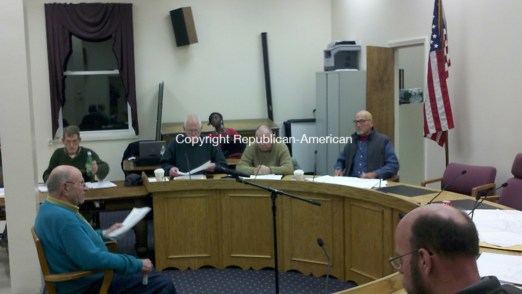 WINSTED, CT - 26 Nov. 2013 - 112613KM01 - The Winsted Zoning Board of Appeals listens to a request for a variance from the town's zoning regulations for a side yard set back on Tuesday night. There has been controversy over the leadership of the panel. Kurt Moffett Republican-American