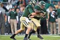 Baylor quarterback Bryce Petty (14) handoff to running back Johnny Jefferson (2) during NCAA football game, Saturday, November 01, 2014 in Waco, Tex. Baylor defeated Kansas 60-14. (Mo Khursheed/TFV Media via AP Images)