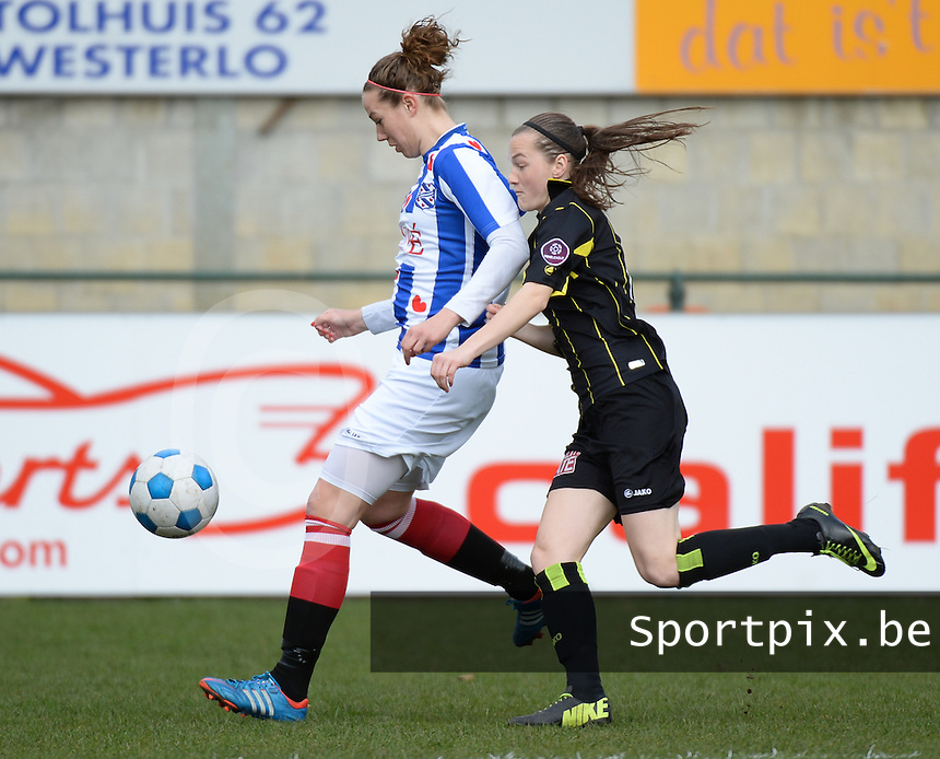 20140315 - WESTERLO , BELGIUM :  Heerenveen Charissa Burgwal pictured with Lierse Elke Van Gorp (r) during the soccer match between the women teams of SK Lierse Dames  and SC Heerenveen Vrouwen , on the 19th matchday of the BeNeleague competition Saturday 15 March 2014 in Westerlo . PHOTO DAVID CATRY