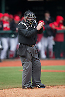 Home plate umpire Michael Cerra during the NCAA baseball game between the Hartford Hawks and the Cornell Big Red at The Ripken Experience on February 28, 2015 in Myrtle Beach, South Carolina.  The Big Red defeated the Hawks 4-3.  (Brian Westerholt/Four Seam Images)
