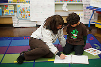 Terri Bartolero visits with her son in his kindergarten class during the 2011-2012 Winter Expo at Melrose Leadership Academy.