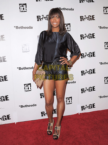 Aisha Tyler.attends the official launch party for 'Rage' in ChinaTown, Los Angeles, California, USA, September 30th 2011..full length  black  navy shiny blue playsuit hand on hip romper .CAP/RKE/DVS.©DVS/RockinExposures/Capital Pictures.