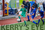 Kerrys David Grebowiec been challenged by Ciaran Kerwin of  Waterford for possession in the u13 Soccer league