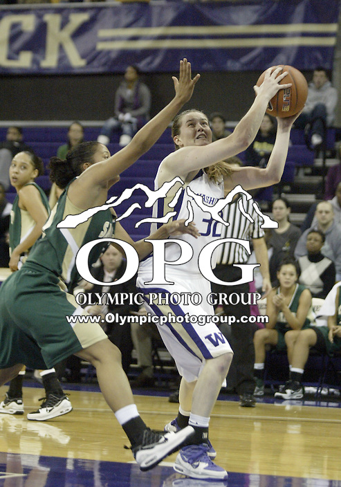 29 November 2009:  Washington Huskies guard #32 Sami Whitcomb goes up for a lay up against Sacramento State. Sacramento State won 74-71 over Washington  at the Bank of America Arena in Seattle, WA.