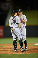 Birmingham Barons relief pitcher Brad Goldberg (8) talks with catcher Zack Collins (24) on the mound during a game against the Pensacola Blue Wahoos on May 8, 2018 at Regions FIeld in Birmingham, Alabama.  Birmingham defeated Pensacola 5-2.  (Mike Janes/Four Seam Images)